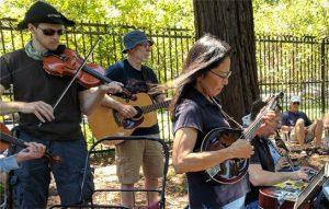 Fiddlers, guitars, dobros, mandolins jamming in San Jose Rose Garden.
